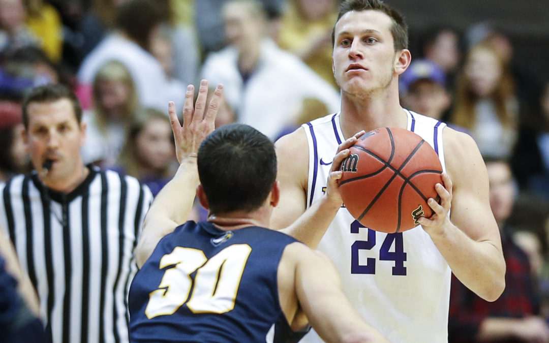 Strong second half propels Bisons past Emory in season opener